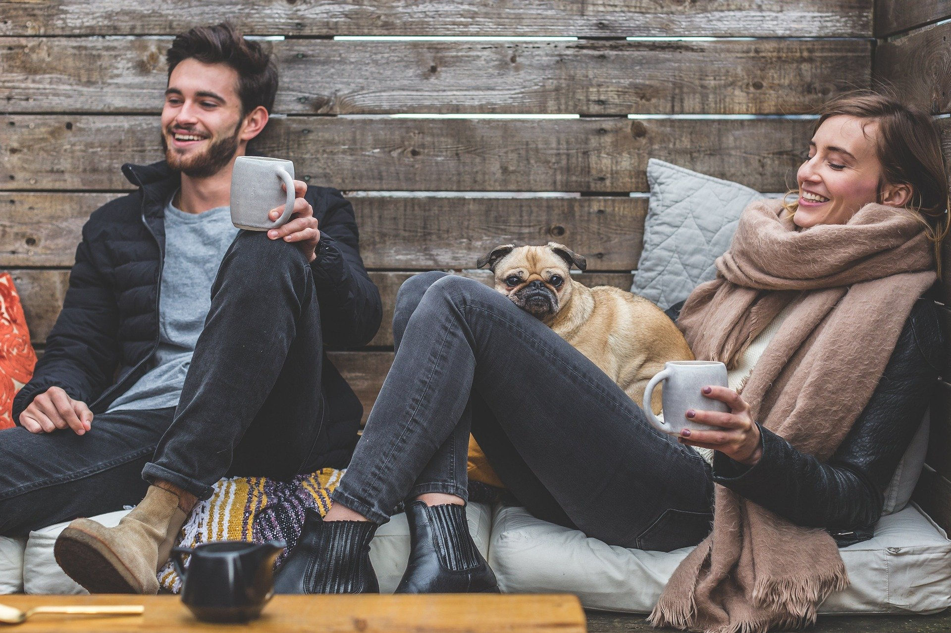 woman and man sitting having coffee and smiling