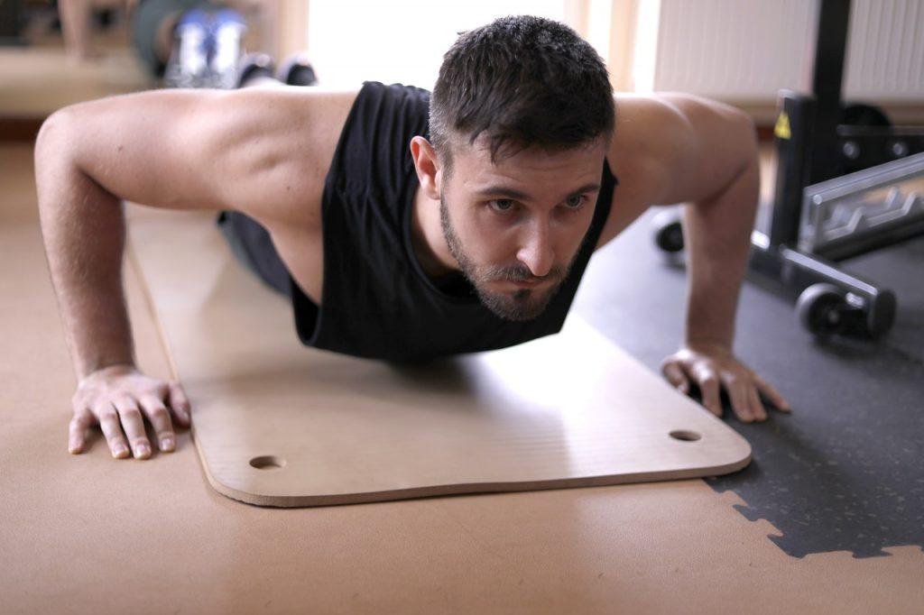 Man doing push ups.